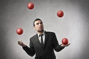 121002-businessman-juggling-lg
